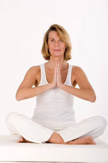 Older lady finds relaxation in yoga sitting in