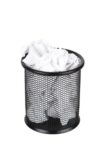 Trash can filled with crumbled paper isolated on white background