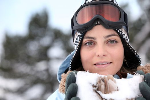Skier holding snow containing jagged wood