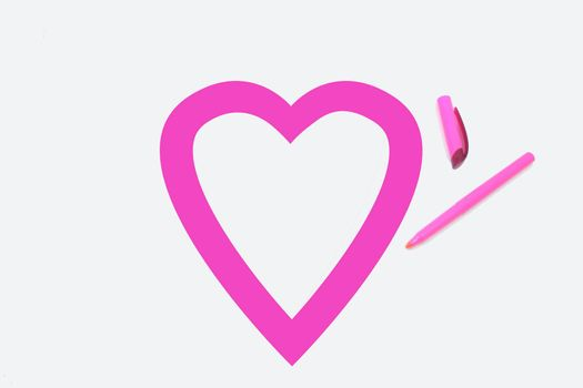 Heart shape colored pink by office highlighter on white background