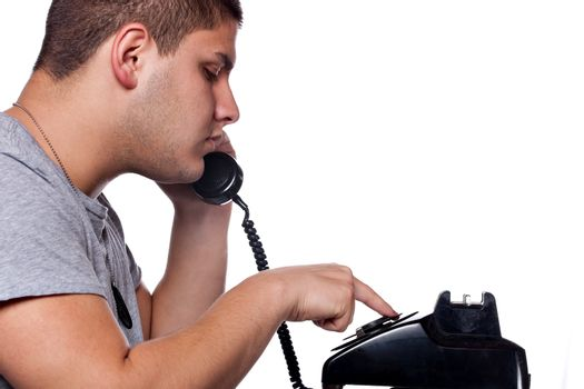 Man Dialing Old Rotary Telephone