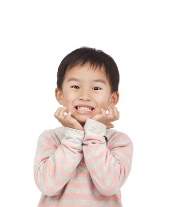 asian kid expressing surprise with his hands in his face