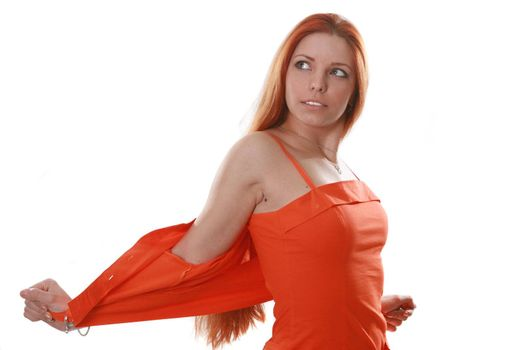 The red long-haired woman moves in a red dress