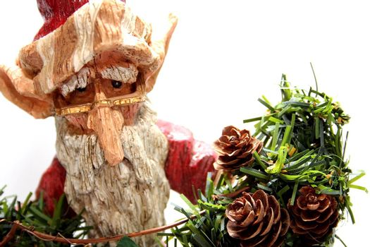 A wooden carving of Santa Claus elf on white background.