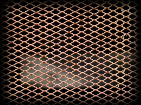Rusted metal grate securing a tunnel hole