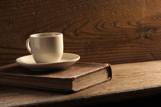 cup of coffee and old books