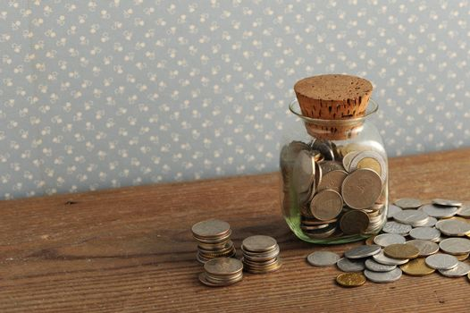 old coins on the wooden table