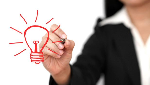 Asian business woman drawing light bulb for creativity concept