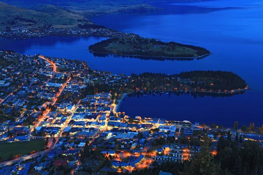 Cityscape of queenstown with lake Wakatipu from top at dusk.