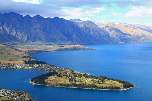 closeup of queenstown with lake Wakatipu from top at noon.