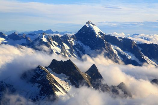 landscape of Mountain Cook Peak with mist from Helicopter, New Zealand