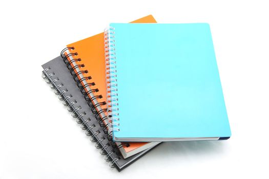 stack of ring binder book isolated on white