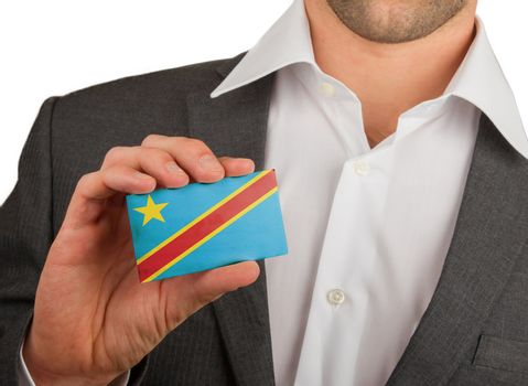 Businessman is holding a business card, The Democratic Republic