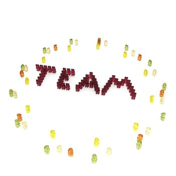 """The word """"team"""" composed from many red gummy bears."""