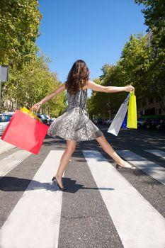 happy shopper on crosswalk