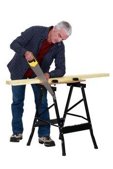 Carpenter sawing wood