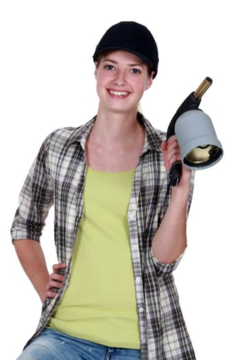 Woman holding blow torch