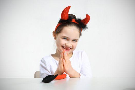 Little girl dressed as pretty imp in studio