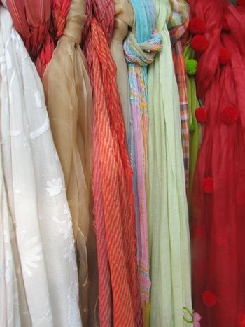 summer scarfs on display, usable as fabric or textile background