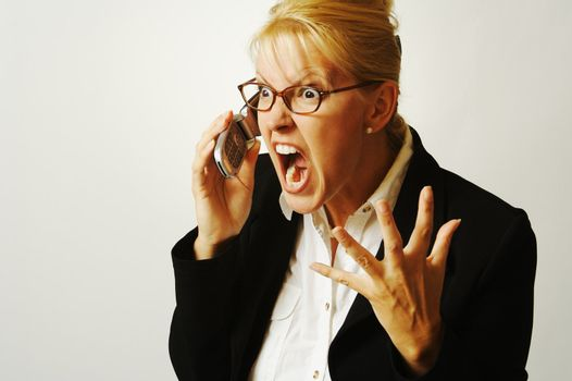 Business woman expresses her anger while on her cell phone.