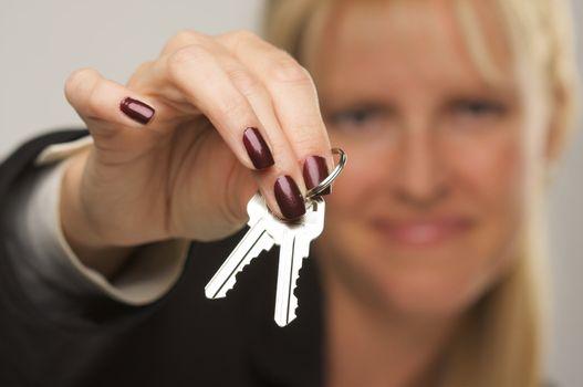 Female presenting keys. Narrow depth of field.
