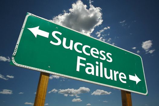 Success, Failure Road Sign with dramatic sky and clouds background.