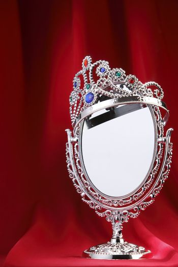 Tiara on top of a mirror.