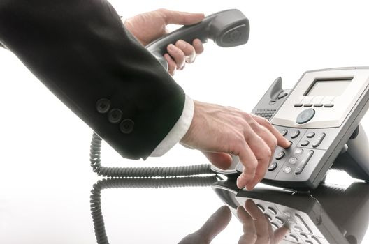 Business man dialing a phone number