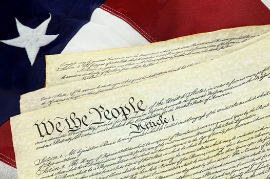 American Constitution with US Flag
