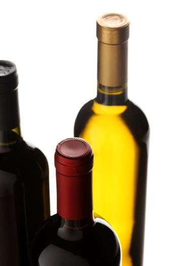 bottles of red and white wine on white background