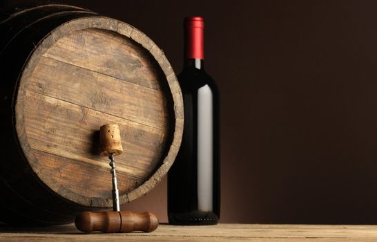 red wine bottle, wodden barrel and corkscrew