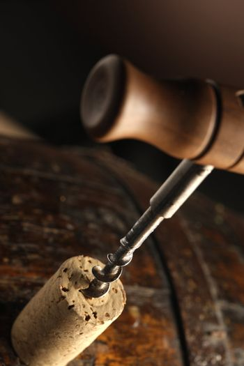 corkscrew and wooden barrel, close up