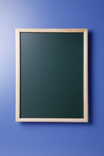 Stock image of blackboard isolated on the blue background.