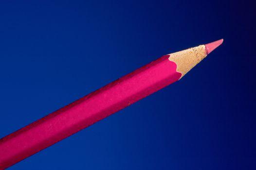Pink pencil on a dark blue background