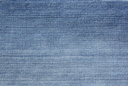Light blue jeans foto as backdrop or abstract textured backgroun