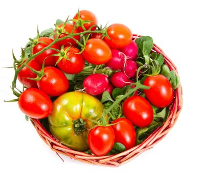 tomatoes in a basket, isolated on white