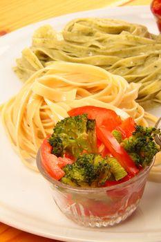 two italian tagliatelles and tomato with broccoli condiment