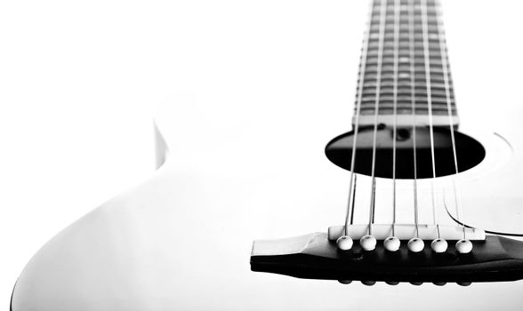 Strings on a guitar. Black-and-white image.