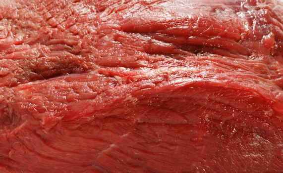 A close-up view of four rump steaks on a white background.