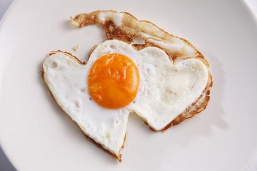 romance breakfast with heart shape fried egg