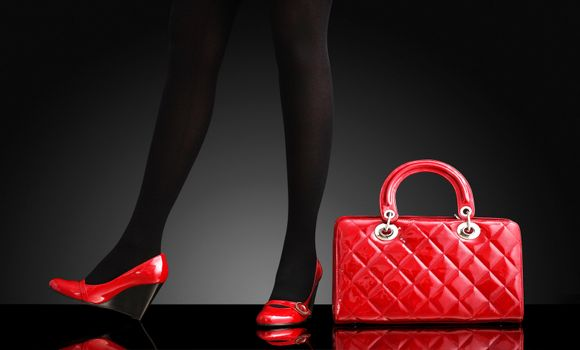 fashionable woman with a red bag, only legs
