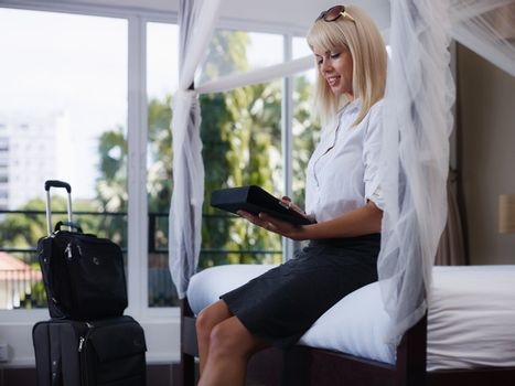 businesswoman sending email on touch pad computer