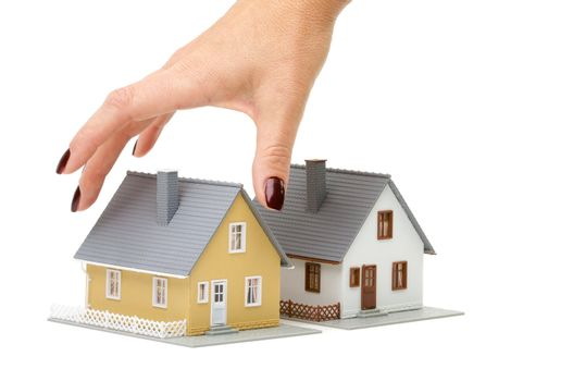 Female hand reaching for house isolated on a white background.
