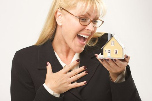 Female holding small house.
