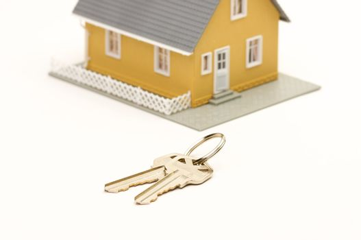 Keys and House isolated on a white background. Focus is on the keys.