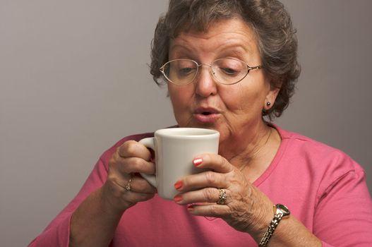 Senior Woman Enjoys a Cup of Coffee