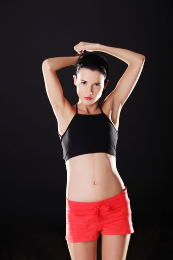Attractive fitness woman in sport clothes