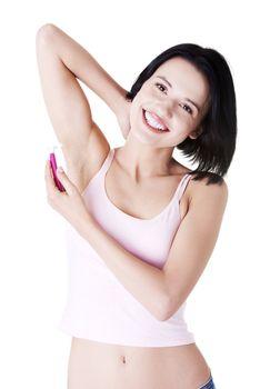 Woman shaving her armpit