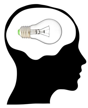 A light bulb shines in the head of a thinking man, concept of a bright idea, invention, inspiration