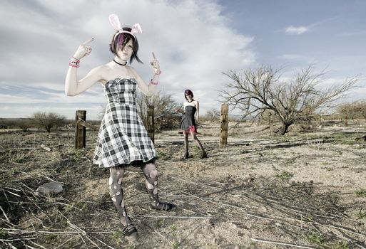 Two punk girls posing in a rural setting